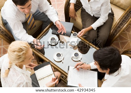 Close ?up of conversation of confident businesspeople in the room - stock photo