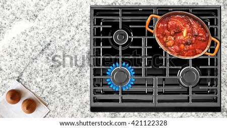 Close-up of cooking food on stove top view - stock photo