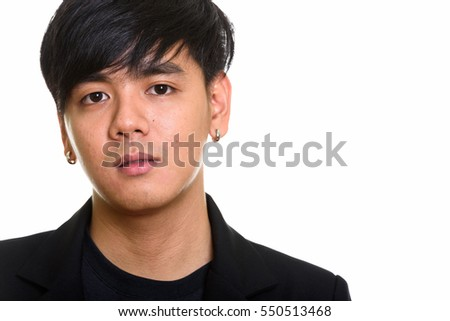 Close up of cool handsome Asian man isolated against white background