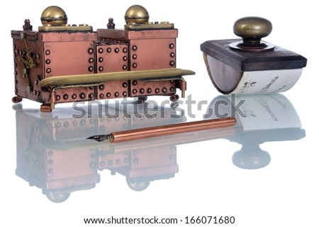 Close-up of copper inkwell and ink pen a on a white background. Style Steampunk. - stock photo
