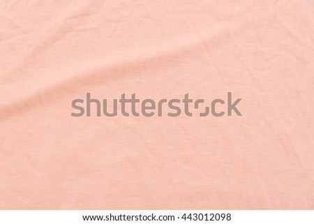 Close up of coral wrinkled bed sheet textured background.