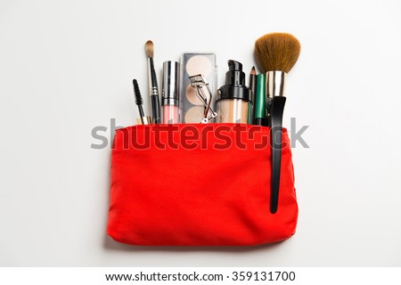 close up of cosmetic bag with makeup stuff - stock photo