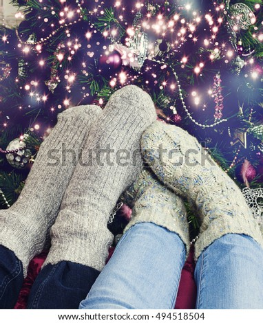 Close-up of couple Feet in wool socks while christmas time