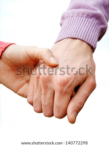 Close-up of couple holding by hands outdoor - stock photo