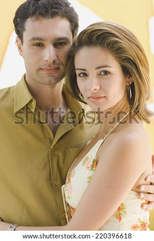 Close up of couple hugging - stock photo
