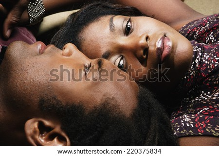 Close up of couple laying head to head - stock photo