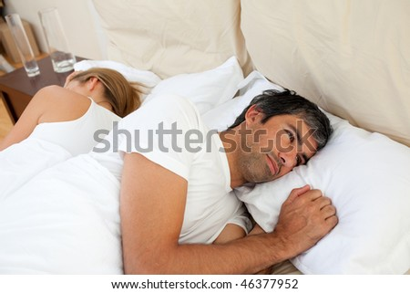 Close-up of couple lying in the bed after having an argument