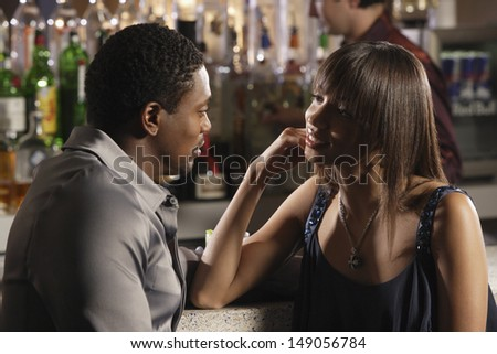 Close up of couple talking at bar - stock photo