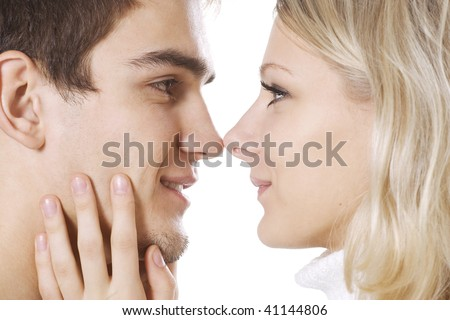 Close-up of couple touching noses - stock photo