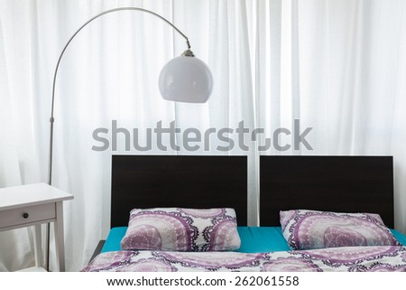 Close-up of cozy stylish bed in luxury bedroom - stock photo