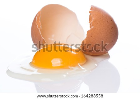 Close up of cracked egg - stock photo