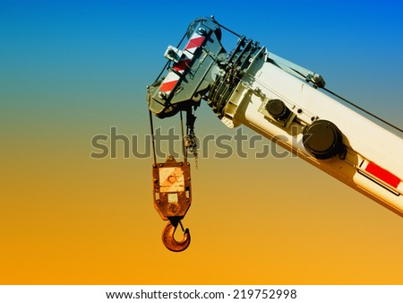 Close up of crane hook on colorful background - stock photo
