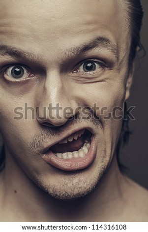 close-up of crazy man with funny facial expression - stock photo