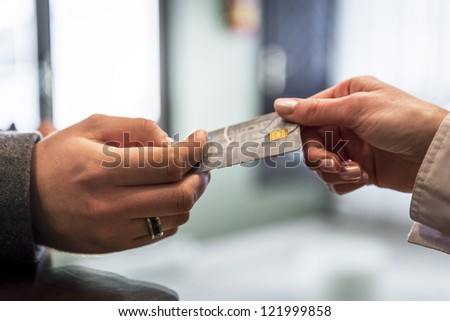 Close-up of credit card in humans hand - stock photo