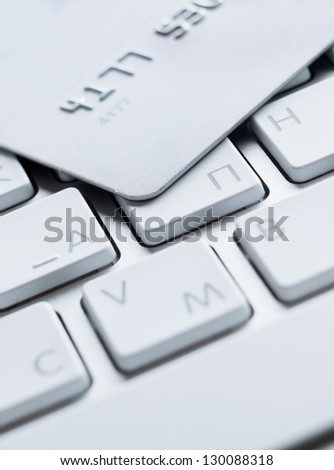 Close up of credit card on a computer keyboard. Concept of internet bargain - stock photo