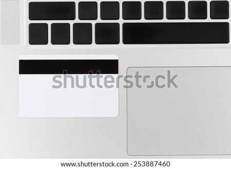 Close up of credit card on computer. Concept of fraud or phishing scheme with technology.  - stock photo