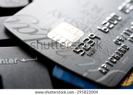 Close up of credit card with chip and numbers, gray and silver theme