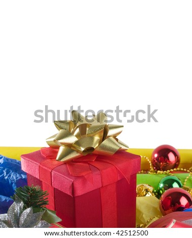 Close up of Cristmas present box with some colorful papper and toys - stock photo