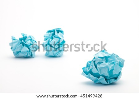 close-up of crumpled paper ball,  blue wadded paper - stock photo