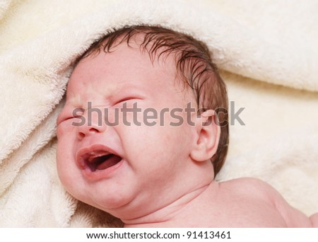 close up of crying baby