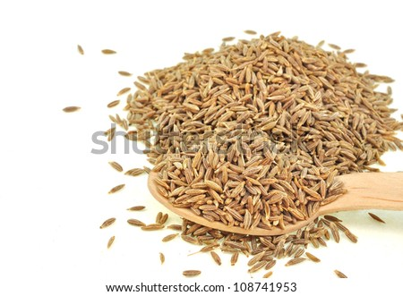 close up of cumin seeds kept in wooden spoon