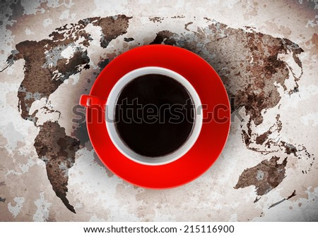 Close up of cup of coffee and world map at background - stock photo