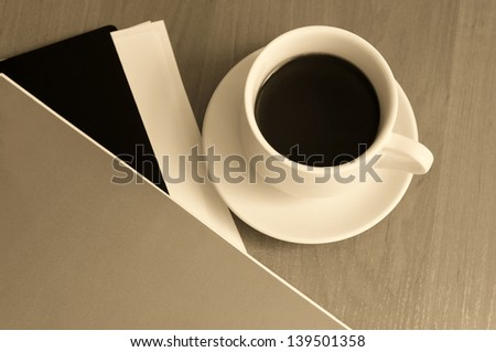 Close-up of cup of coffee on the table. Businessman's lunch