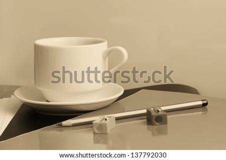 Close-up of cup of coffee on the table. Education concept - stock photo