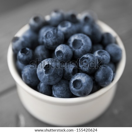 close-up of cup of fresh blueberries (shallow DOF) - stock photo