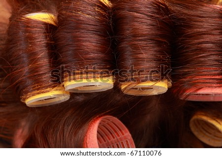close-up of curlers in hair - stock photo