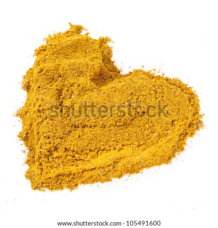 Close-up of curry spice, heart  isolated on white background.