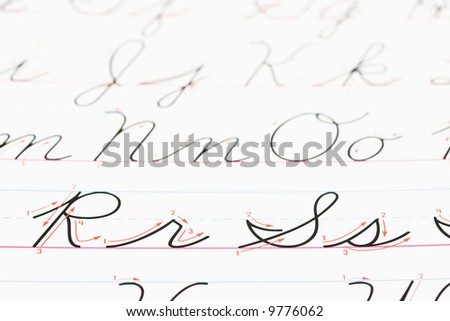 Close up of cursive handwriting practice page. - stock photo