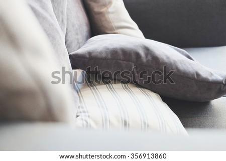 Close up of cushion on sofa - stock photo