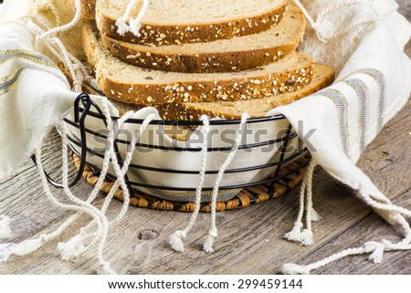 Close up of cut whole grain bread in a basket.