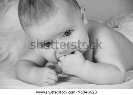 Close-up of cute baby girl. Black and white image