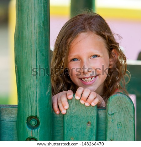 close up of Cute girl next to wooden fence. - stock photo