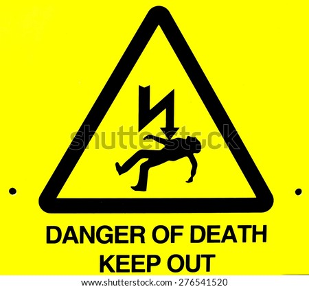 Close up of danger of death yellow warning sign - stock photo