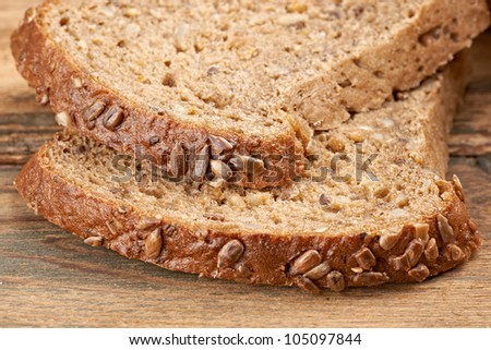 close up of  dark bread on table - stock photo