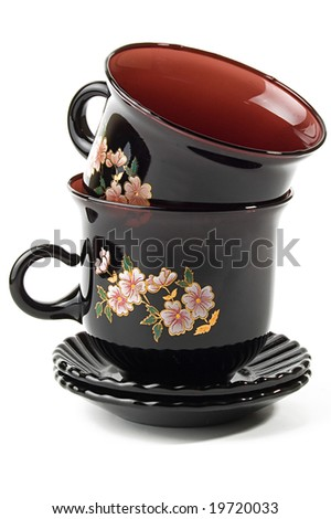 close-up of dark red dishes set for two on white - stock photo