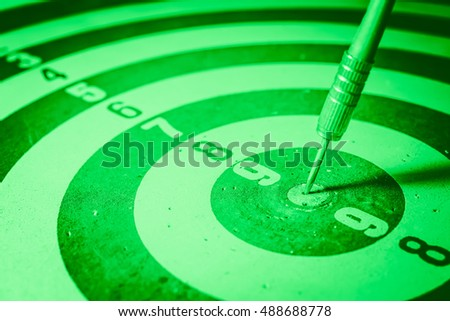 Close-up of darts arrows in the target center. Smart goal setting, dart hit the center of dartboard. Hit to the point. Business concept. - Vintage Tone