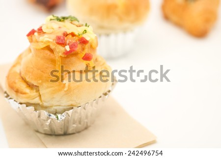 Close up of delicious and fresh baked bun on a napkin for refreshment on event - stock photo