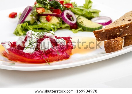 close up of delicious gravlax with fresh salad and two pieces of