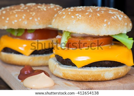 Close up of delicious homemade cheeseburgers. - stock photo