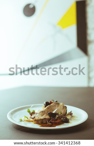 Close-up of delicious meat on white plate - stock photo