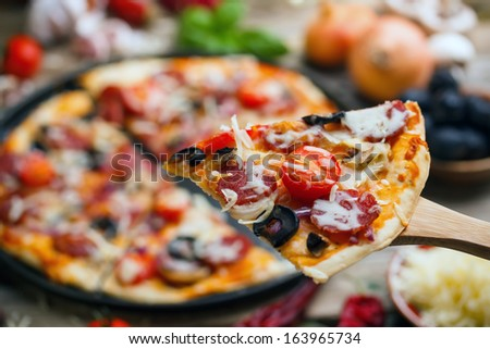 Close up of delicious sausage pizza - stock photo