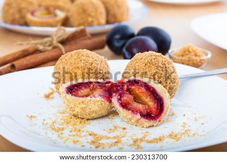 Close up of delicious sweet plum dumplings on white plate - stock photo