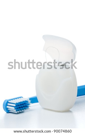 Close-up of dental floss and a toothbrush - stock photo