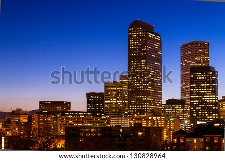 Close up of Denver Colorado skyline at dusk during the blue hour with lighted buildings