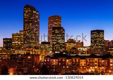 Close up of Denver Colorado skyline at dusk during the blue hour with lighted buildings - stock photo
