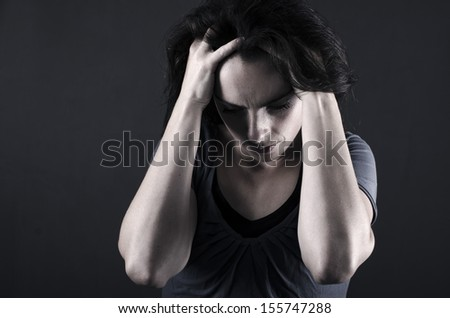 Close up of depressed woman - stock photo